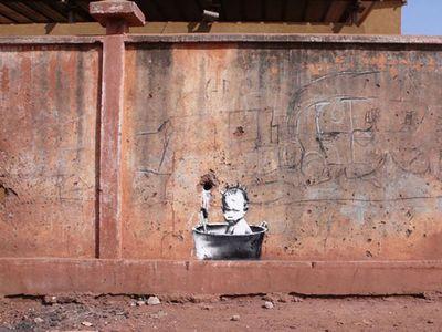 Banksy-graffiti-street-art-babybath[1]